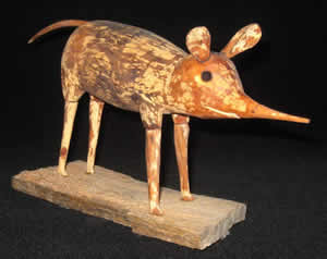 Wood sculpture of a checkered sengi